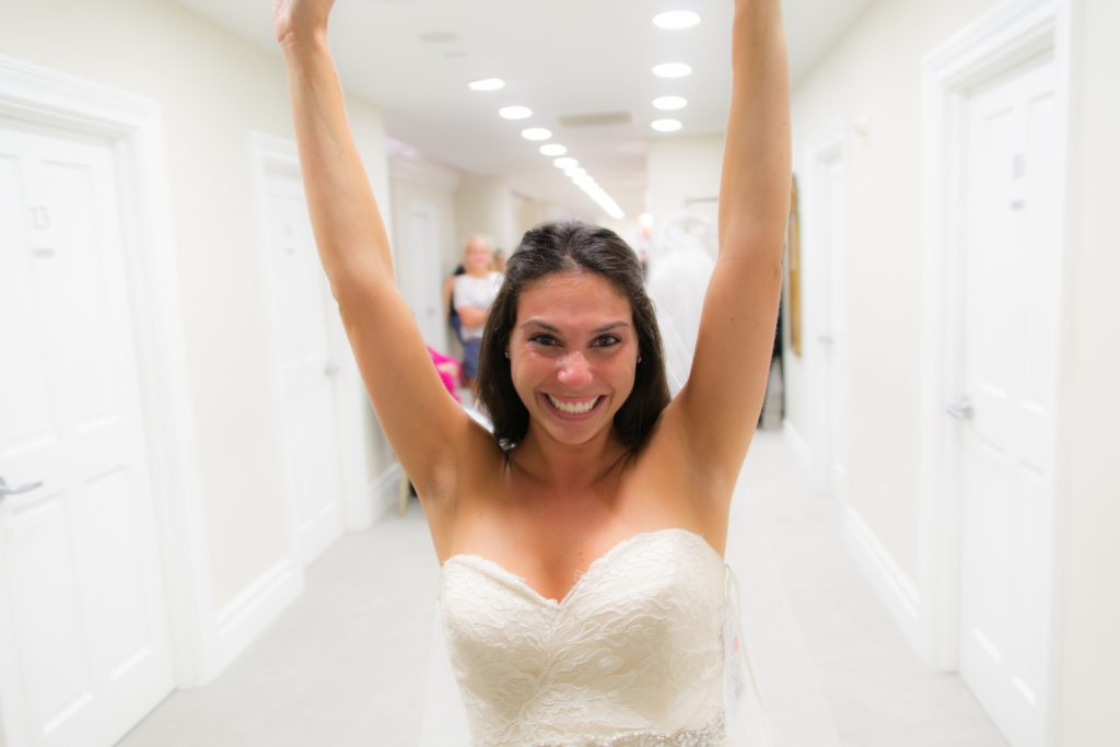 excited bride at sample studio