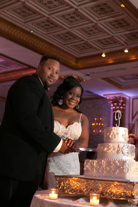 Racheal and Robert bride and groom cutting cake