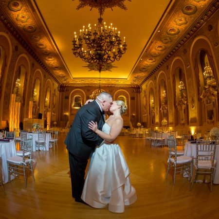 Samantha and Joseph, bride and groom kissing in ballroom