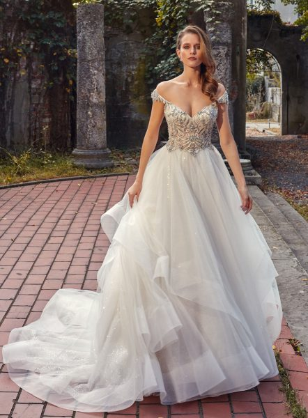Off-the-shoulder V-neck A-line Wedding Dress With Beaded Bodice And Ruffle Skirt by Eve of Milady - Image 1