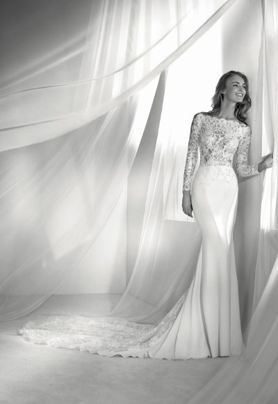 Long Sleeve Off-the-shoulder Illusion Fit And Flare Wedding Dress With Statement Back And Sweep Train by Pronovias