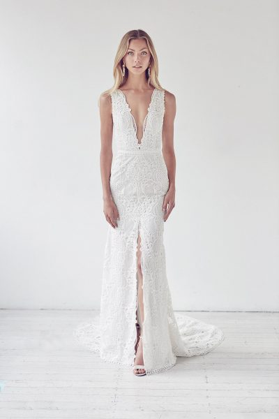 Deep V-neck Lace Fit And Flare Center Slit Wedding Dress by Suzanne Harward - Image 1