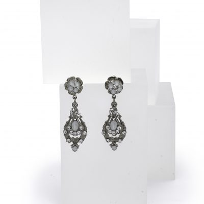 Silver Floral Dropped Earrings With Clear And White Swarovski Crystals by Maria Elena