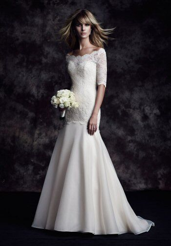 Off The Shoulder 3/4 Sleeve Lace Fit And Flare Wedding Dress by Paloma Blanca - Image 1