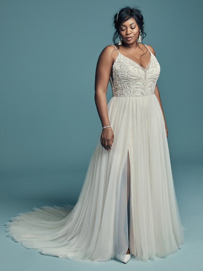 Wedding dress with a plunging V line neck, and slit in the skirt