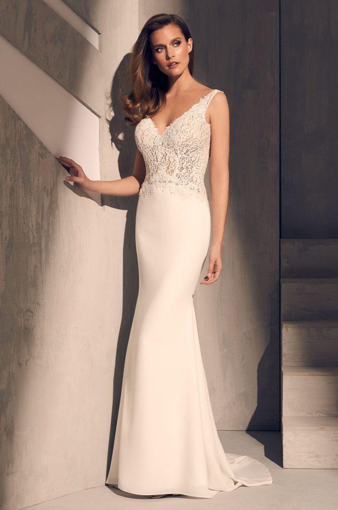 Sleeveless V-neck Lace Bodice Crepe Skirt Fit And Flare Wedding Dress by Mikaella - Image 1