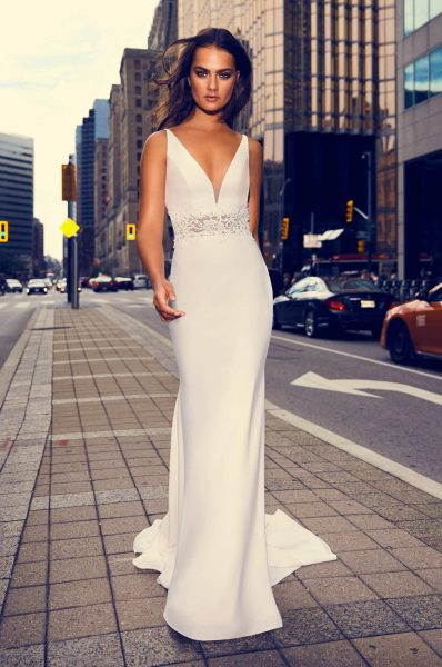 Sleeveless V-neck Crepe Sheath Wedding Dress With Illusion Lace At Midriff by Paloma Blanca - Image 1