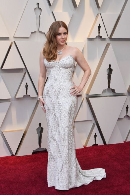 Amy Adams in Versace dress, Cartier jewelry and Christian Louboutin heels. Photo- MARK RALSTON:AFP:Getty Images