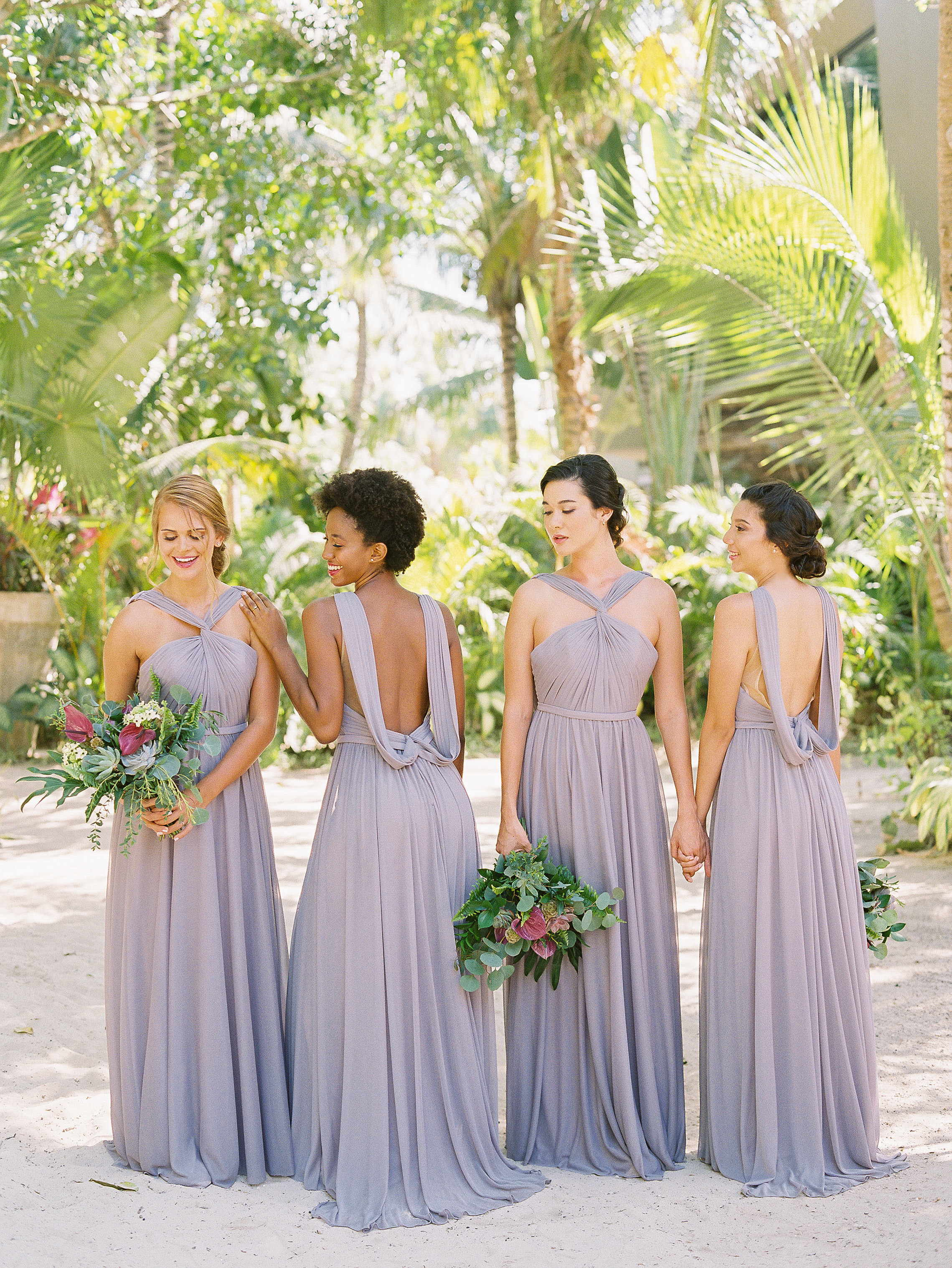 Affordable bridesmaids dresses perfect for destination weddings—We took Kleinfeld Bridal wedding dresses and Kleinfeld Bridal Party bridesmaids dresses to Tulum, Mexico for a fun photoshoot on the beach full of flowers, sun, sand and fun!