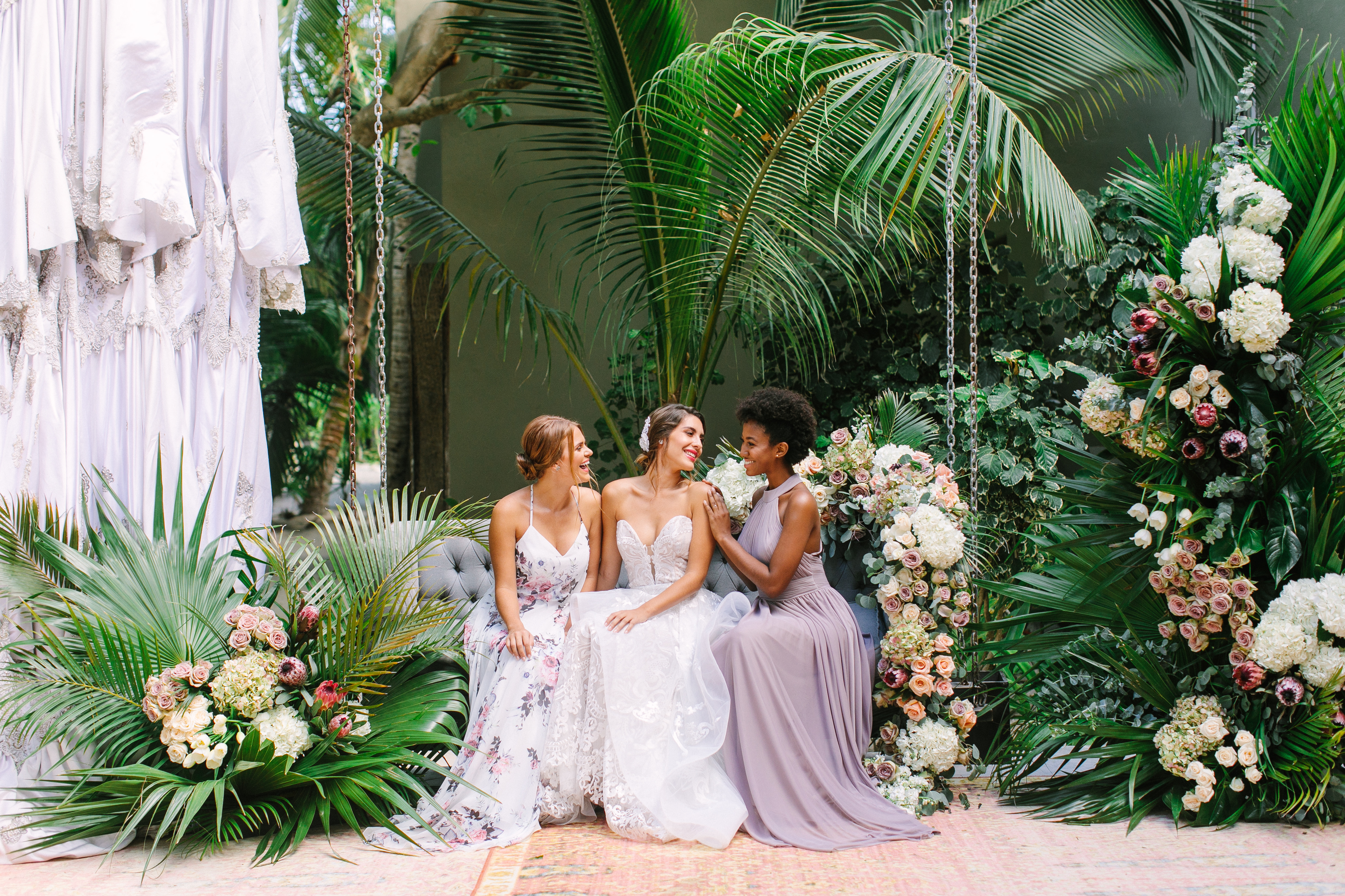 We're Obsessed with Weddings in Tulum–Here's Why! We took Kleinfeld Bridal wedding dresses and Kleinfeld Bridal Party bridesmaids dresses to Tulum, Mexico for a fun photoshoot on the beach full of flowers, sun, sand and fun!