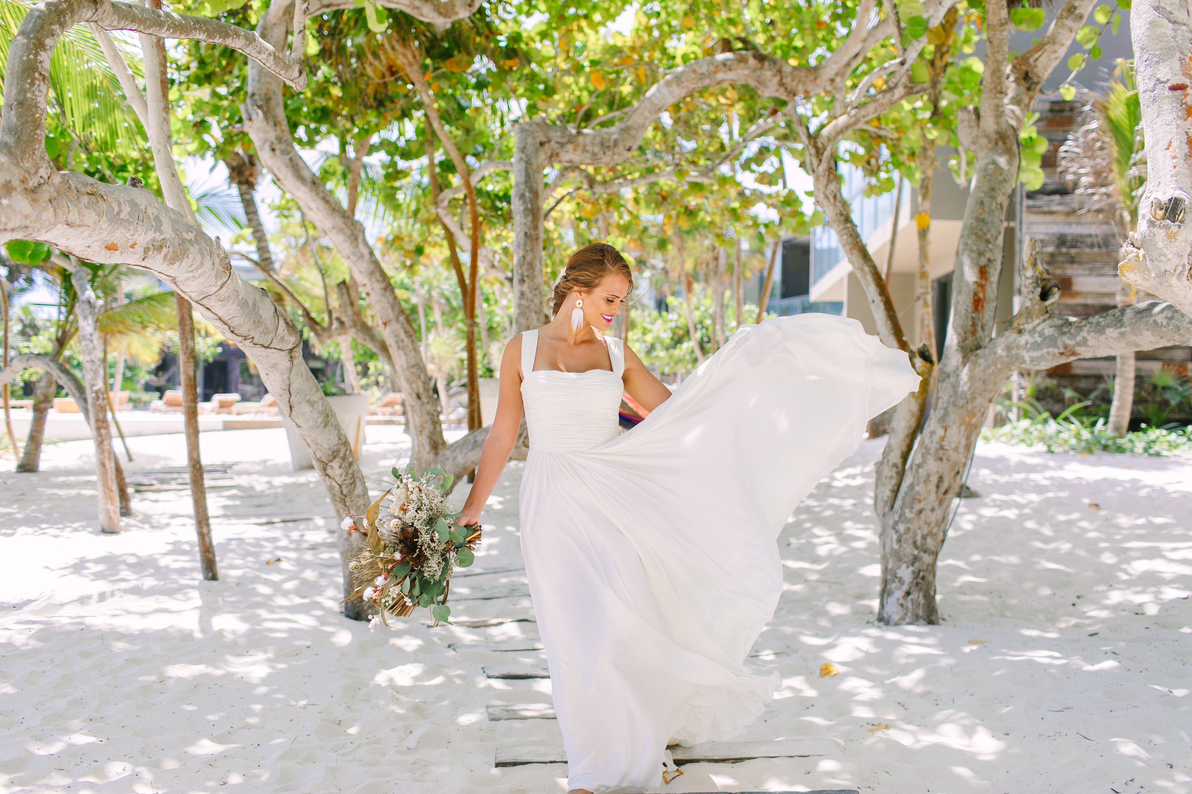 Tulum Weddings Are Unbelievably Romantic—Here's Proof: We took Kleinfeld Bridal wedding dresses and Kleinfeld Bridal Party bridesmaids dresses to Tulum, Mexico for a fun photoshoot on the beach full of flowers, sun, sand and fun!
