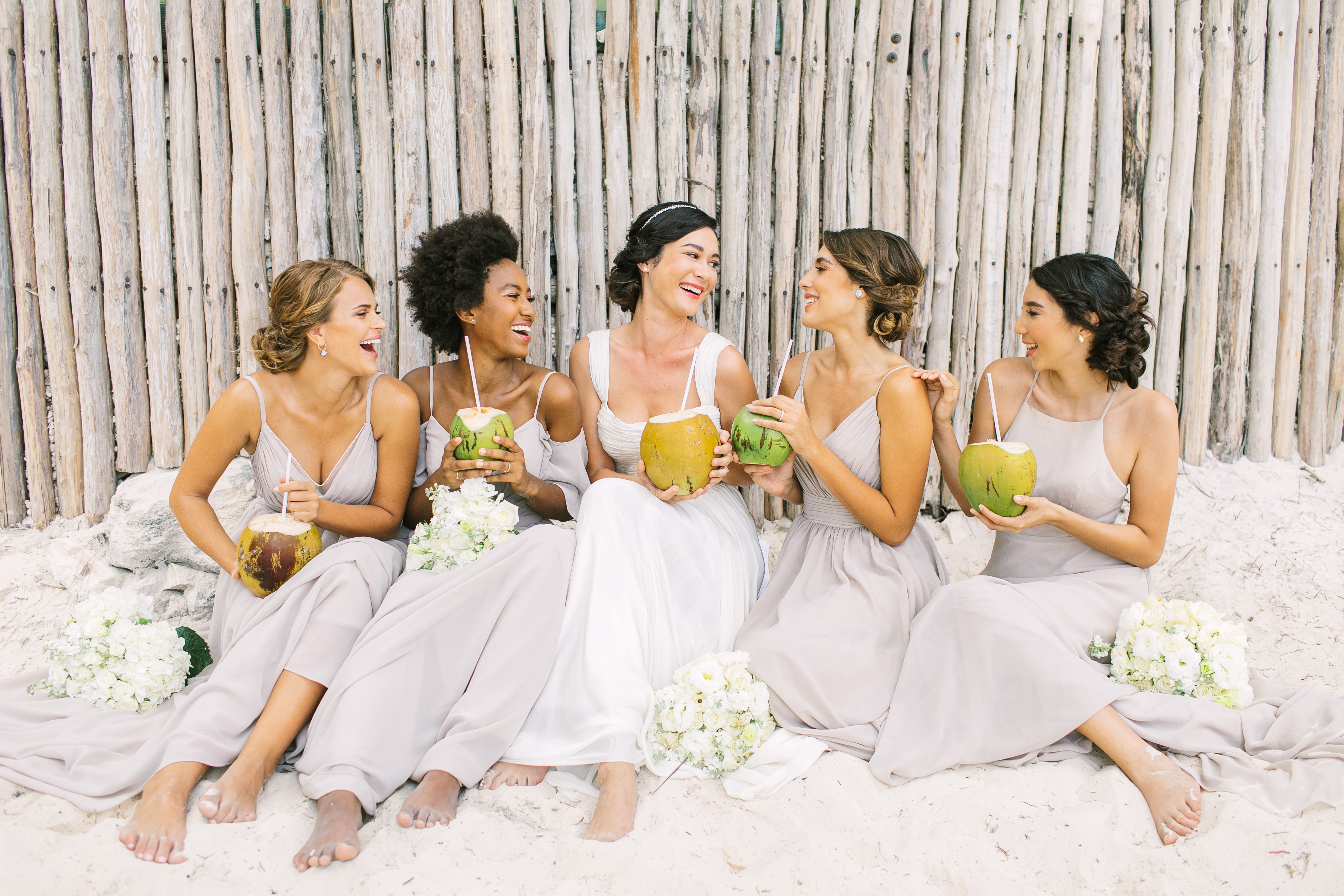 Here are top instagram-worthy moments you must capture on your wedding day! We took Kleinfeld Bridal wedding dresses and Kleinfeld Bridal Party bridesmaids dresses to Tulum, Mexico for a fun photoshoot on the beach full of flowers, sun, sand and fun!