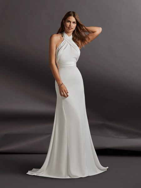 4ad488e1 Halter Neckline Crepe Sheath Wedding Dress by Pronovias - Image 1