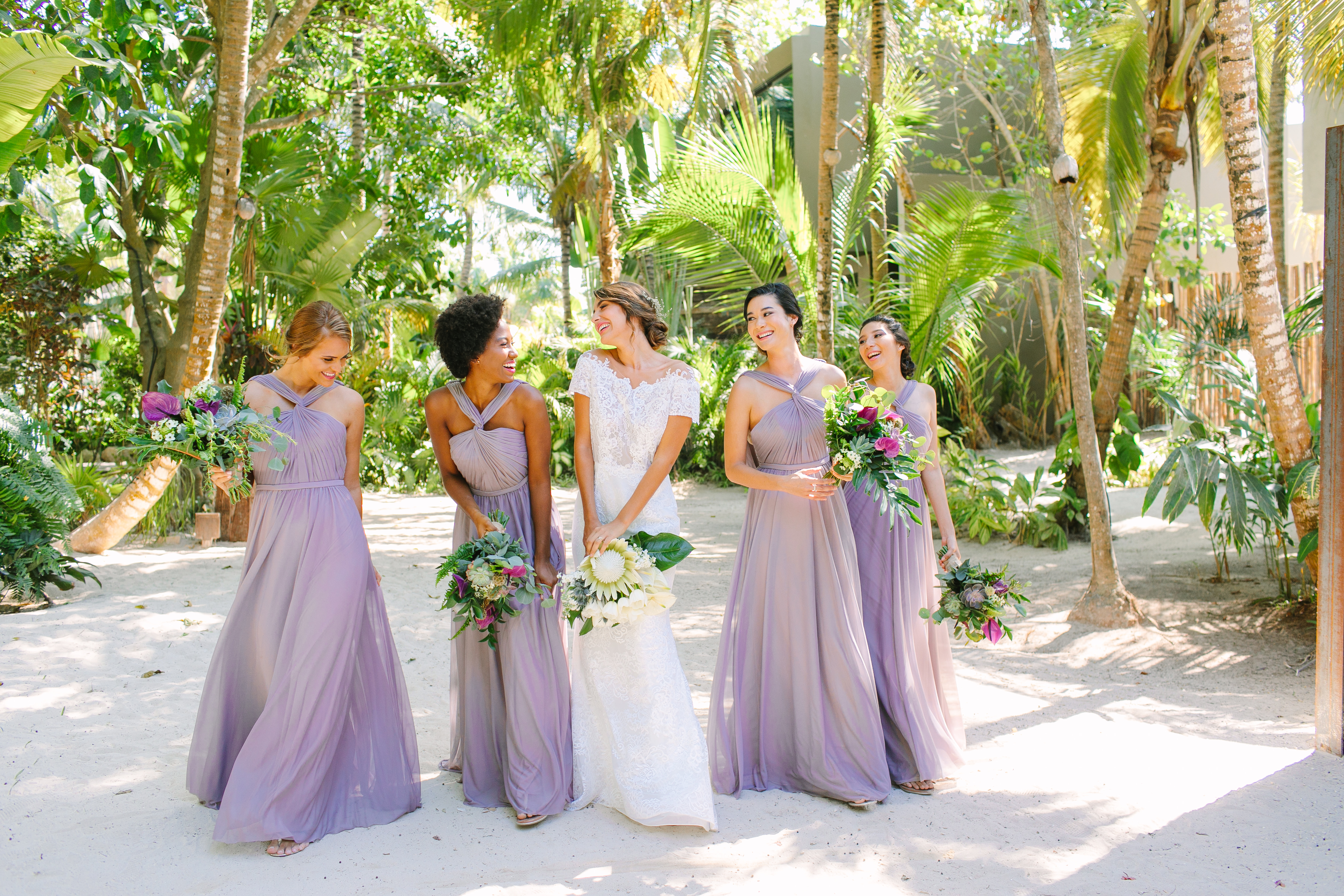 7 tips for wedding photos you'll love: We took Kleinfeld Bridal wedding dresses and Kleinfeld Bridal Party bridesmaids dresses to Tulum, Mexico for a fun photoshoot on the beach full of flowers, sun, sand and fun!