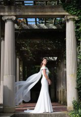 Silk Crepe Sheath Wedding Dress With Off The Shoulder Bateau Neckline And Cape by Modern Trousseau - Image 1