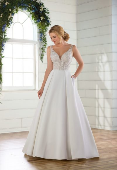 Sleeveless v-neckline ballgown with beaded and embroidered bodice and satin skirt by Essense of Australia