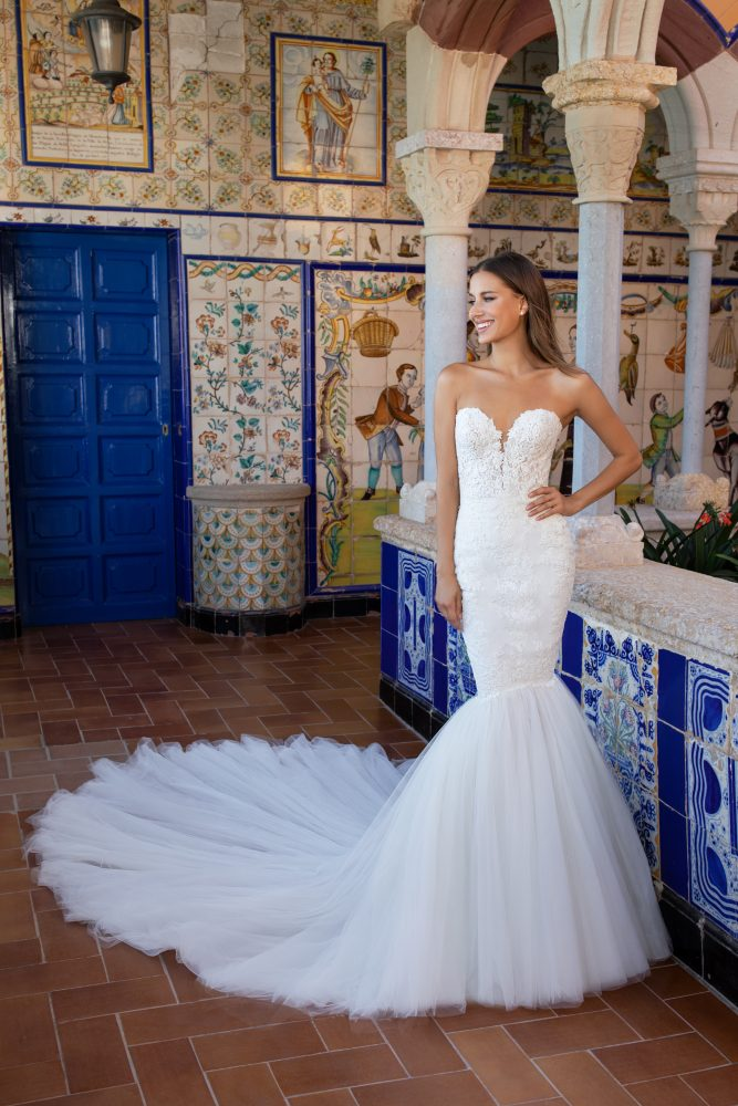 Strapless sweetheart neckline lace mermaid wedding dress with tulle skirt by Pronovias x Kleinfeld - Image 1