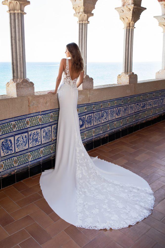 Sleeveless v-neckline lace embroidered crepe sheath wedding dress with sheer bodice by Pronovias x Kleinfeld - Image 2