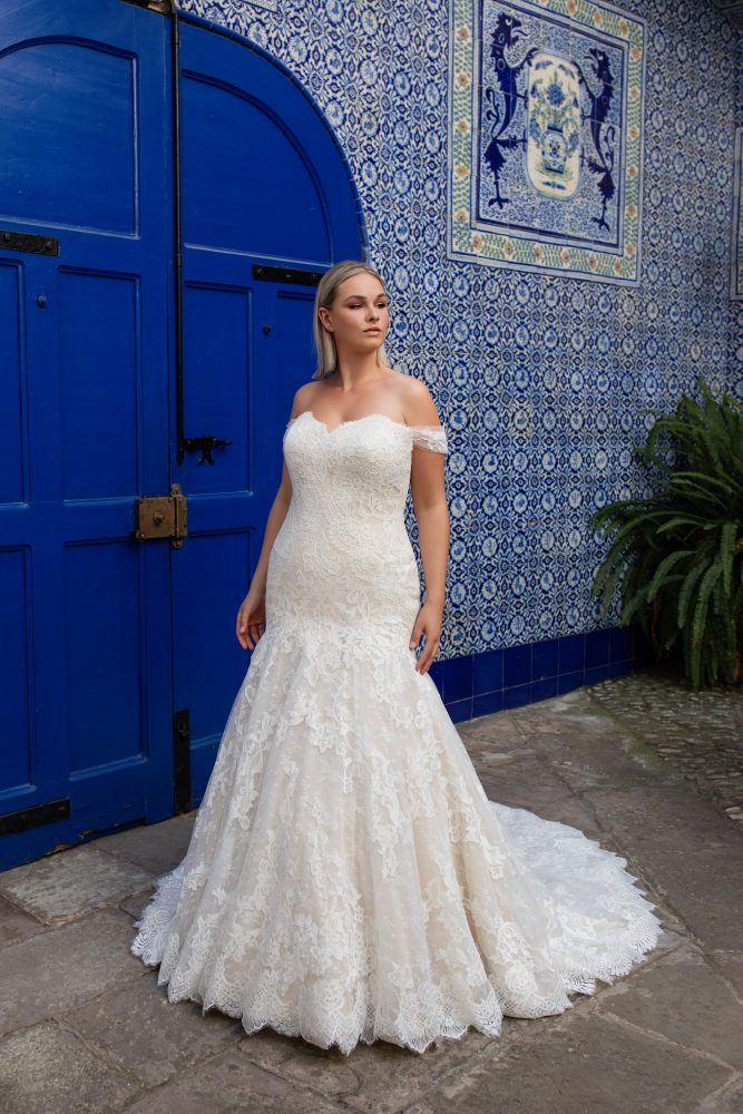 Off-the-shoulder sweetheart neckline lace mermaid wedding dress by Pronovias x Kleinfeld - Image 1