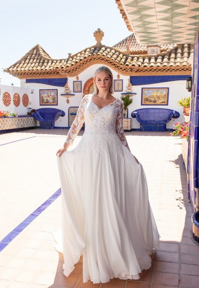 V-neckline lace embroidered a-line wedding dress with illusion long sleeves and chiffon skirt by Pronovias x Kleinfeld