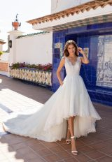 Sleeveless v-neckline lace a-line wedding dress with high low skirt by Pronovias x Kleinfeld - Image 1