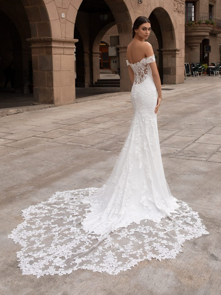 Off-the-shoulder Crepe Fit And Flare Wedding Dress With Lace Accented Train by Pronovias - Image 2