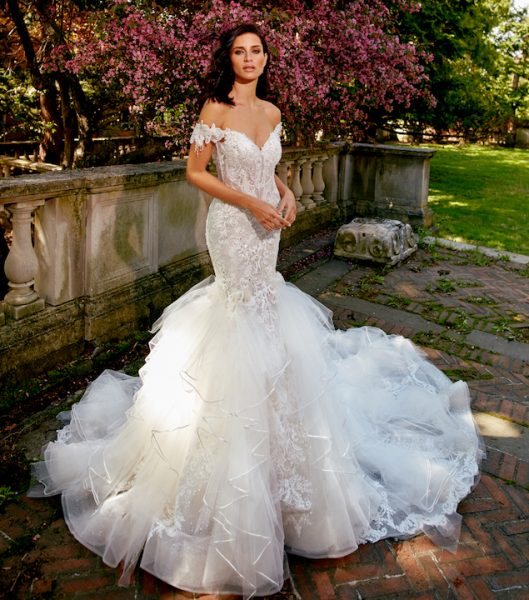Off The Shoulder V-Neck Fit And Flare Wedding Dress With Ruffled Skirt by Eve of Milady - Image 1