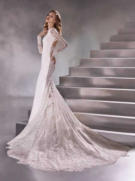 Long Sleeve High Neck Sheath Wedding Dress With Lace Back by Pronovias - Image 1