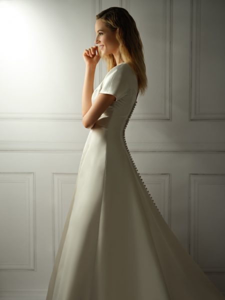Cap Sleeve V-neckline Satin A-line Wedding Dress With Buttons On Back by Michelle Roth - Image 1