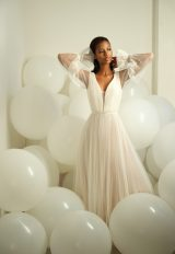 Draped Long Sleeve V-neckline A-line Blush Wedding Dress by Michelle Roth - Image 1