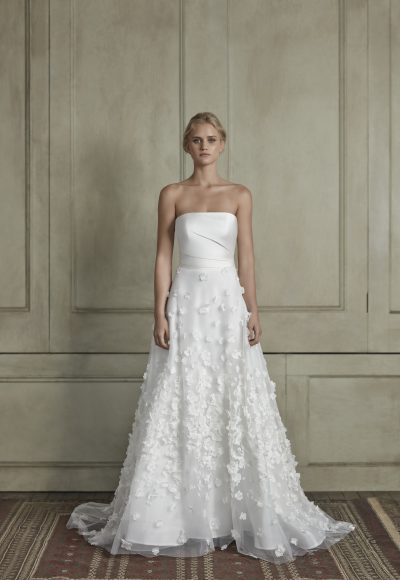 Strapless straight neckline sheath wedding dress with floral appliqué tulle skirt by Sareh Nouri
