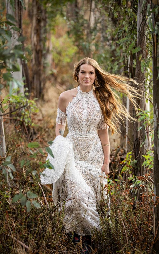 BOHO INSPIRED FIT-AND-FLARE WEDDING DRESS WITH FRINGE DETAILS by All Who Wander - Image 1