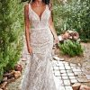 MODERN BOHEMIAN WEDDING DRESS WITH NUDE CUTOUTS by All Who Wander - Image 1