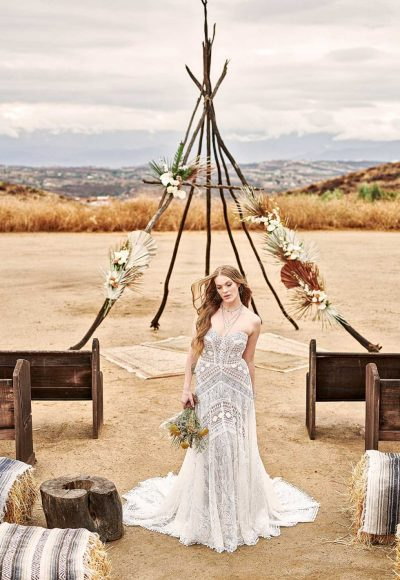 STRAPLESS BOHO WEDDING GOWN WITH GRAPHIC LACE AND DETACHABLE SLEEVES by All Who Wander