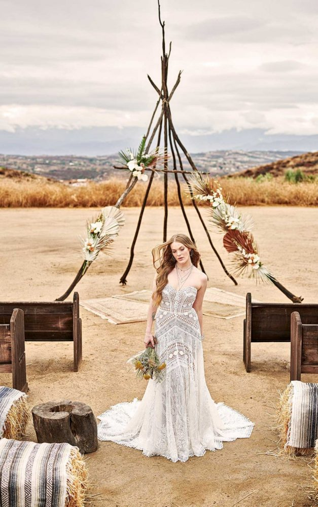 STRAPLESS BOHO WEDDING GOWN WITH GRAPHIC LACE AND DETACHABLE SLEEVES by All Who Wander - Image 1