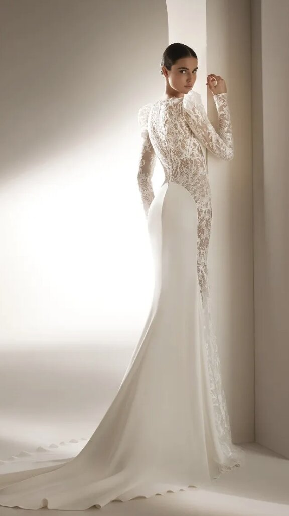 Crepe Mermaid Wedding Dress With Puff Sleeves by Pronovias - Image 2