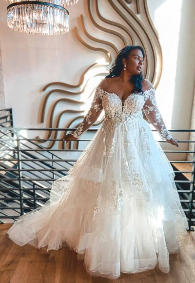 Off The Shoulder Lace Plus Size Ballgown Wedding Dress With Tiered Skirt by Essense of Australia