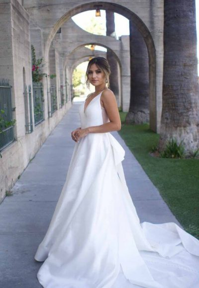 Clean Modern Ball Gown With Wide Straps And Bow by Martina Liana