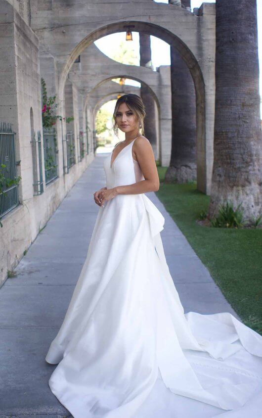 Clean Modern Ball Gown With Wide Straps And Bow by Martina Liana - Image 1