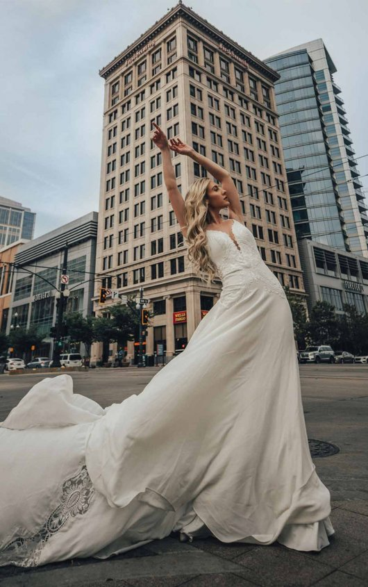 Embroidered Boho Wedding Dress With Textured Lace And Plunging Sweetheart Neckline by All Who Wander - Image 1