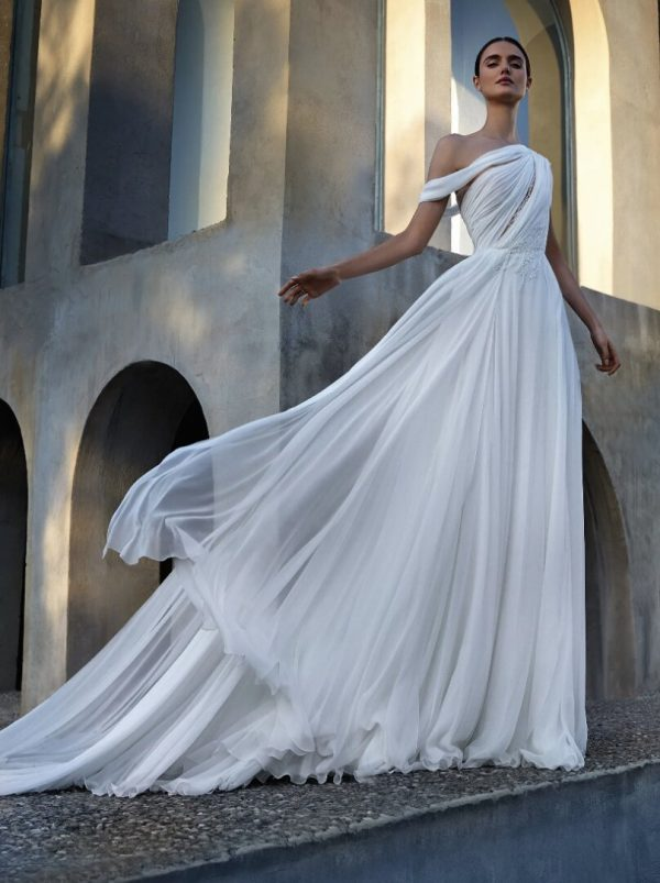 Off The Shoulder Flared Wedding Dress With Asymmetrical Neckline And Asymmetrical Back by Pronovias - Image 1