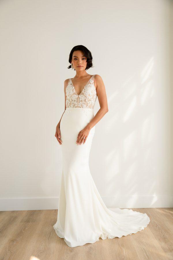 Sleeveless V-neckline Sheath Wedding Dress With Semi Sheer Bodice And Stretch Crepe Skirt by Rebecca Schoneveld - Image 1