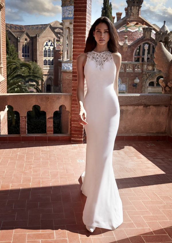 Sleeveless Crepe Sheath Wedding Dress with Beaded Neckline by Pronovias x Kleinfeld - Image 1