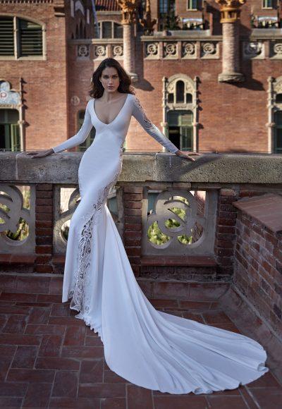 Long Sleeve V-neckline Sheath Wedding Dress with Lace Inserts by Pronovias x Kleinfeld