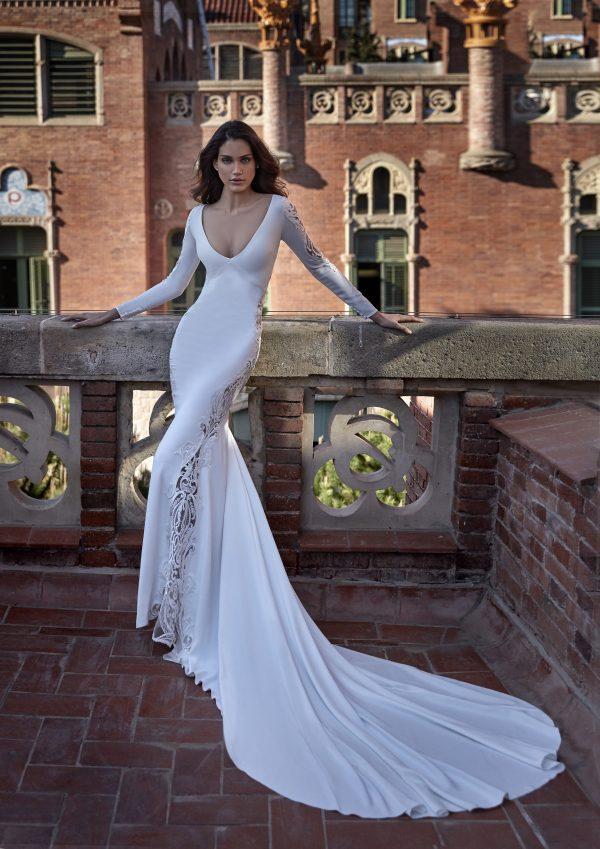Long Sleeve V-neckline Sheath Wedding Dress with Lace Inserts by Pronovias x Kleinfeld - Image 1