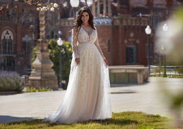 Long sleeve v-neckline A-line wedding dress with beading and lace by Pronovias x Kleinfeld - Image 1