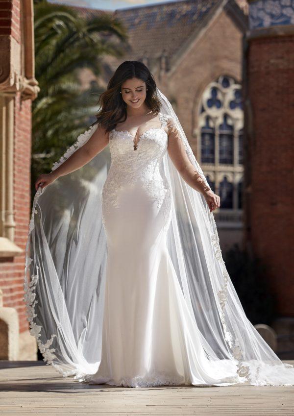 Sleeveless Crepe Sheath Wedding Dress with Lace Details by Pronovias x Kleinfeld - Image 1