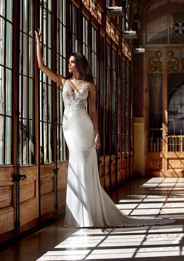 Sleeveless V-neckline Sheath Wedding Dress with Beaded Lace Bodice and Crepe Skirt by Pronovias x Kleinfeld - Image 1
