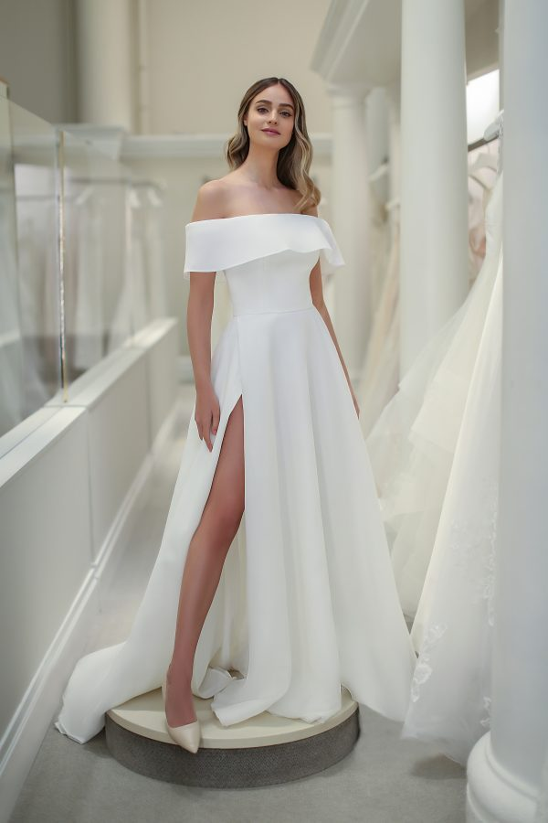 Off The Shoulder A-line Wedding Dress With Front Slit by Michelle Roth - Image 1
