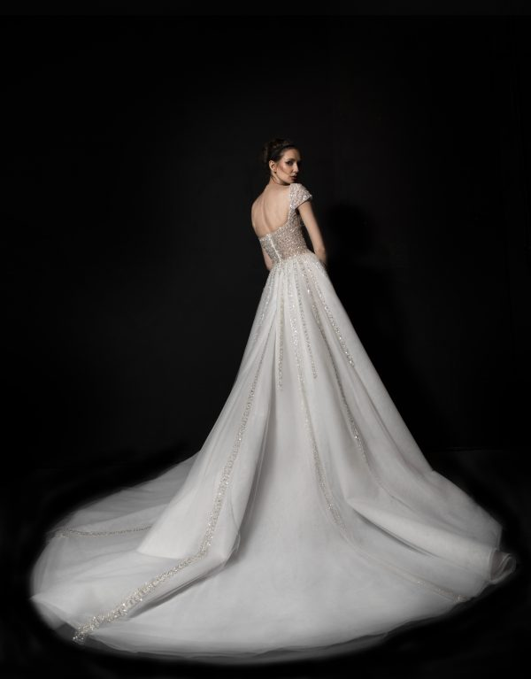 Short Sleeve A-line Wedding Dress With Embellished Bodice And Tulle Skirt With Sparkle Detailing by Tony Ward - Image 2